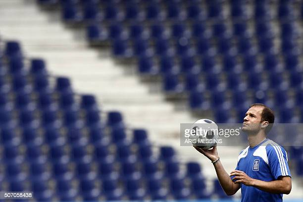 Greek midfielder Angelos Basinas plays with the ball during a team training session in Salzburg on June 9 one day before their Group D game against...