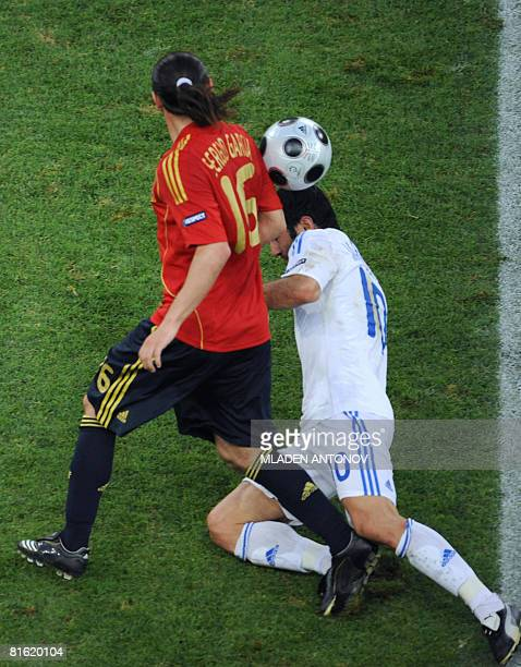 Greek midfielder Georgios Karagounis vies for the ball with Spanish forward Sergio Garcia during the Euro 2008 Championships Group D football match...