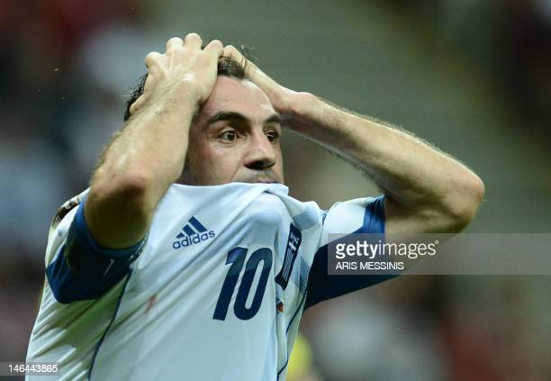 Greek midfielder Giorgos Karagounis reacts during the Euro 2012 championships football match Greece vs Russia on June 16, 2012 at the National...