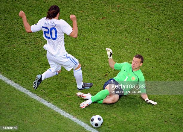 Greek midfielder Ioannis Amanatidis vies with Russian goalkeeper Igor Akinfeev during the Euro 2008 Championships group D football match Greece vs...