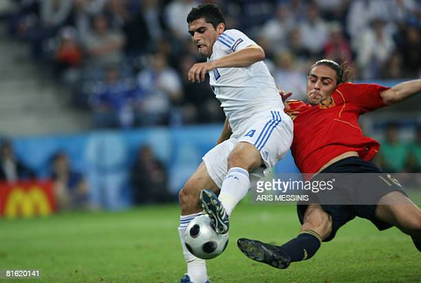 Greek midfielder Nikos Spiropoulos vies with Spanish forward Sergio Garcia during the Euro 2008 Championships Group D football match Greece vs. Spain...