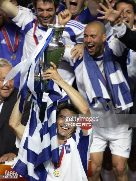 Greek midfielder Theodoros Zagorakis holds the Henry Delaunay trophy 04 July 2004 at the Luz stadium in Lisbon at the end of the Euro 2004 final...