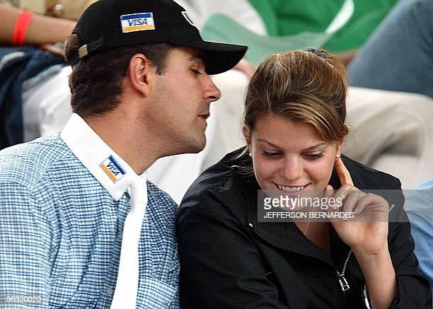 Greek millionaire Athina Onassis Roussel talks with her Brazilian fiance and rider Alvaro Affonso de Net Miranda during an international equestrian...
