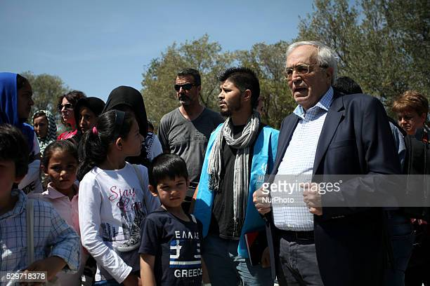 Greek MInister of Culture Aristidis Mpaltas greets refugees at the Acropolis on Europe Day in Athens May 9 2016 The ministry organized a tour on the...