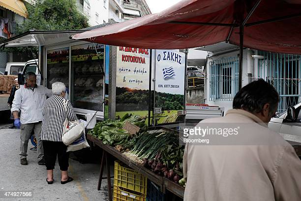 A Greek national flag decorates a refrigeration van selling chickens at a farmer's market on Kassandrou street in Thessaloniki Greece on Thursday May...