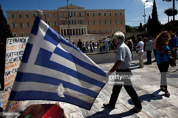 A Greek national flag flies outside the national parliament during a 48hour strike by Greece's biggest publicsector union ADEDY in central Athens...