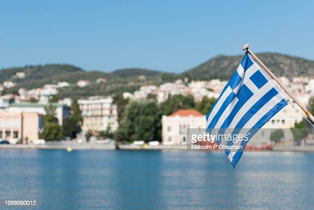 greek national flag on back of boat, mytilene, lesvos, greece - greece stock pictures, royalty-free photos & images