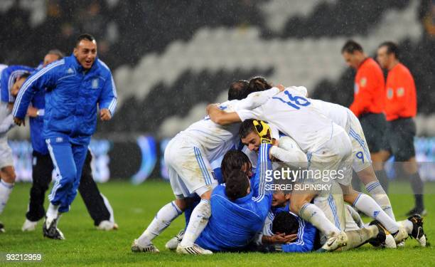 Greek national football team players celebrate after their World Cup 2010 playoff qualification football match against Ukraine on November 18 2009 in...