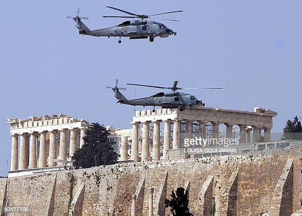 Greek navy military helicopters fly over the Ancient Acropolis in Athens during the military parade marking the Greek Independence Day 25 March 2005...