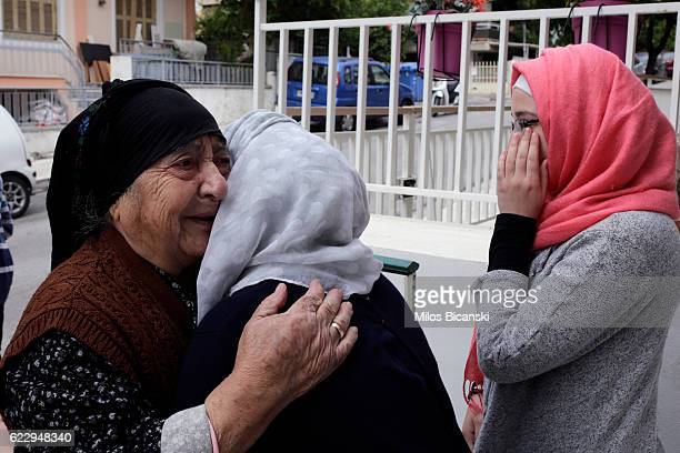 Greek neighbour says goodbye and cries with Syrian Refugees Sham Asaaid Alkhateb and Doha Asaaid Alkhateb at their temporary home in Athens the day...