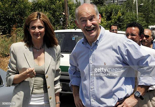 Greek opposition leader George Papandreou and his wife Ada smile after they cast their votes in a polling station in Athens City 13 June 2004...