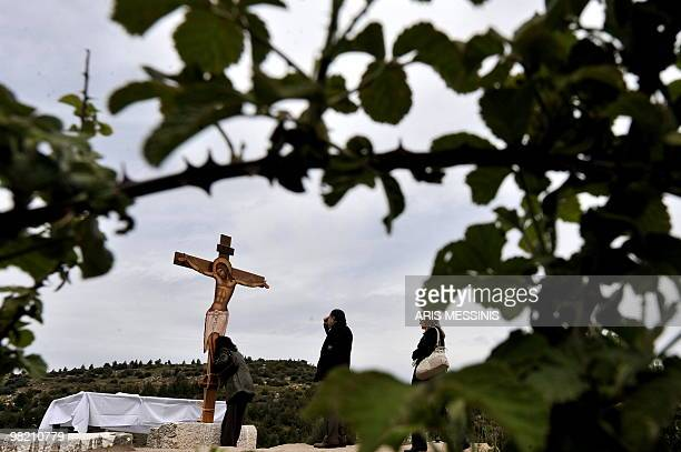 Greek Orthodox believers offer prayers before an image of Jesus during the Apokathelosis which marks the removal of Christ's body from the Cross...