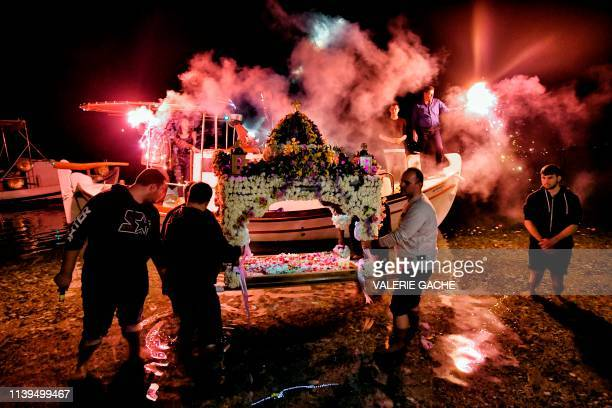 TOPSHOT Greek Orthodox Christians carry the Good Friday Epitaph at a beach of Loutraki Greece on April 26 2019 Millions of Greeks flock to churches...