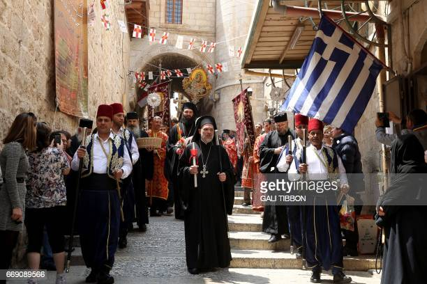 Greek Orthodox clergymen attend the Easter Sunday procession in Jerusalems Old City on April 16 2017 Thousands of Christians marked Jesus's...
