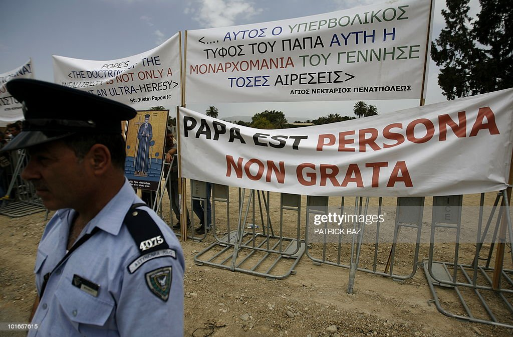 Greek Orthodox Cypriots protest outside the Eleftheria Sports Centre in Nicosia on June 6, 2010 as Pope Benedict XVI holds a mass inside on the third and final day of the pontiff's visit to the mostly Greek Orthodox Mediterranean island.