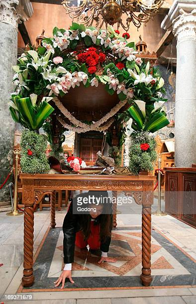 Greek orthodox devotee under the epitaphios on Good friday