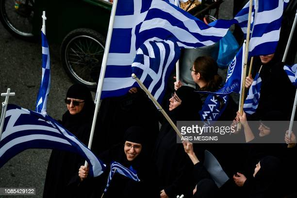 Greek Orthodox nuns and others protesters take part in a demonstration near the Greek Parliament against the agreement with Skopje to rename...