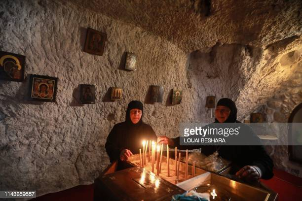 Greek Orthodox nuns light candles during prayer at the convent of Saint Takla in the ancient Christian town of Maalula 56 kilometres northeast of the...