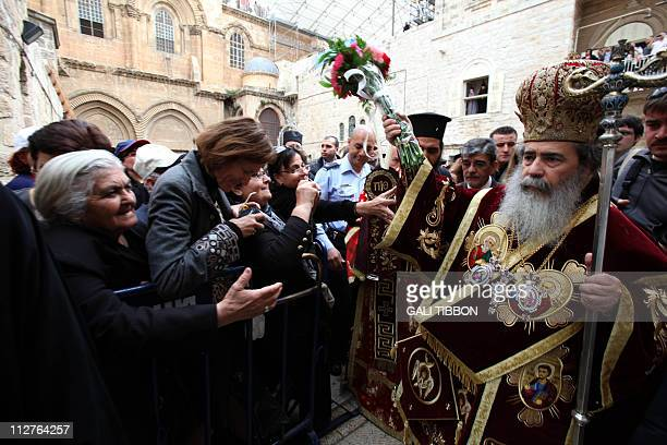 Greek Orthodox Patriarch of Jerusalem Theofilos III blesses worshipers before the traditional washing of the feet ceremony at the Church of the Holy...