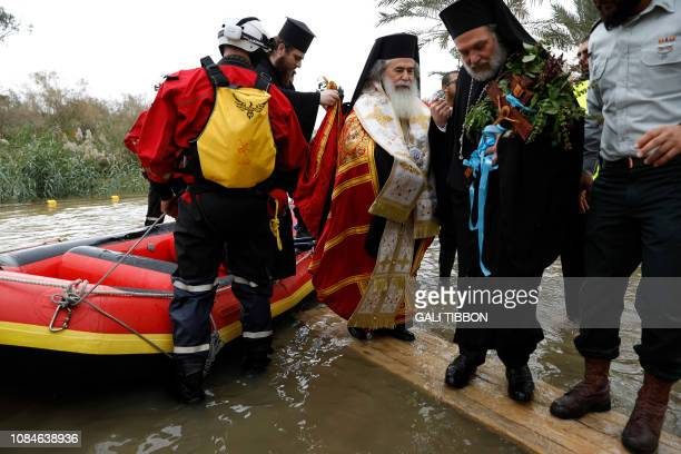 Greek Orthodox Patriarch of Jerusalem Theophilos III comes off the boat after blessing the waters of the Jordan River on January 18 2019 during the...
