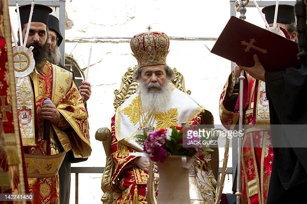 """Greek Orthodox Patriarch of Jerusalem Theophilos III conducts the """"Washing of the Feet"""" ceremony at the Church of the Holy Sepulchre, in the old city..."""
