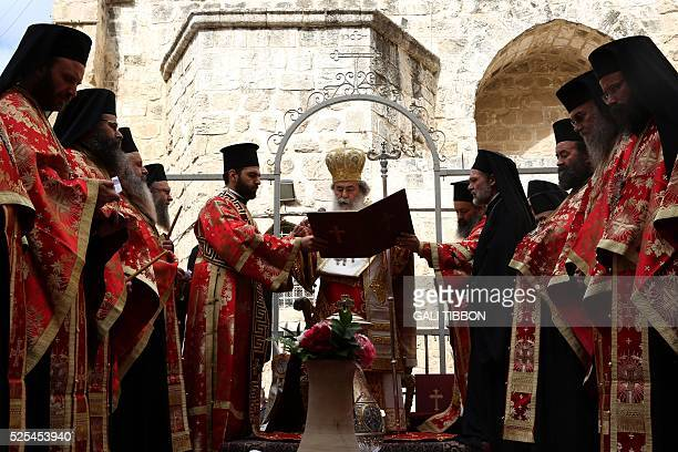 Greek Orthodox Patriarch of Jerusalem Theophilos III conducts the Washing of the Feet ceremony in front of the Church of the Holy Sepulchre in...