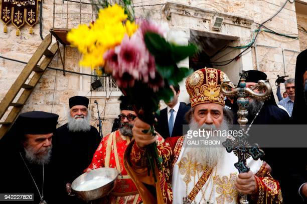 Greek Orthodox Patriarch of Jerusalem Theophilos III conducts the traditional Washing of the Feet ceremony in front of the Church of the Holy...