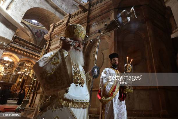 Greek Orthodox Patriarch of Jerusalem Theophilos III leads the Orthodox Easter Sunday mass at the Church of the Holy Sepulchre in Jerusalem's Old...