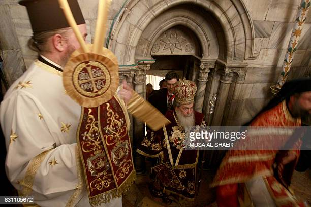 Greek Orthodox Patriarch of Jerusalem Theophilos III leads the midnight mass at the Church of the Nativity in the biblical West Bank town of...