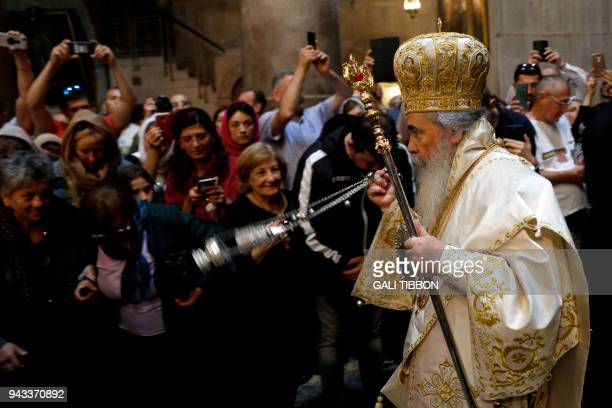 Greek Orthodox Patriarch of Jerusalem Theophilos III swings an incense censer during the Orthodox Easter Sunday mass at the Church of the Holy...