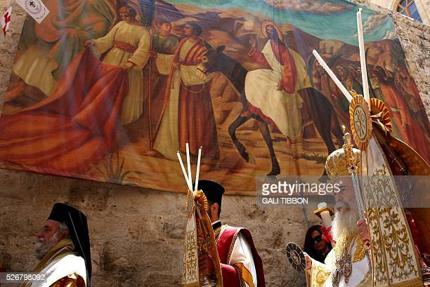 Greek Orthodox Patriarch of Jerusalem Theophilos III walks past Easter decorations during the Orthodox Easter Sunday procession to the Church of the...