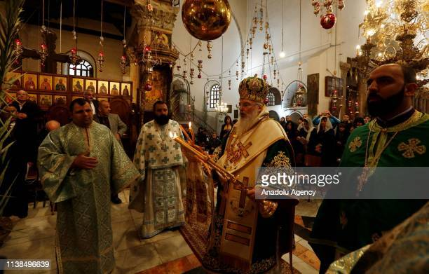 Greek Orthodox Patriarch Theophilctus leads a ritual at Church of the Nativity to mark the Palm Sunday in Bethlehem West Bank on April 21 2019 Palm...