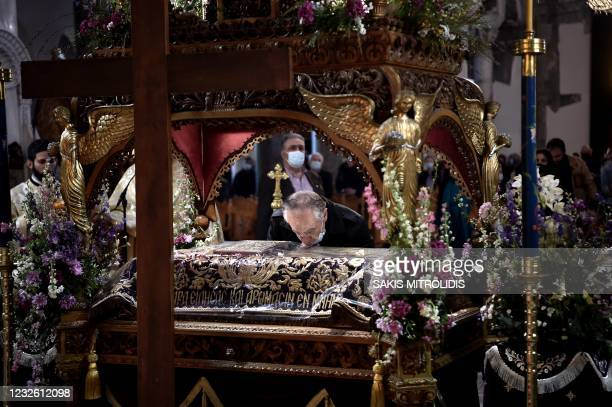 Greek Orthodox pilgrims attend a church service following the Epitafios procession at a church in Thessaloniki on April 30, 2021. - Greeks flock to...