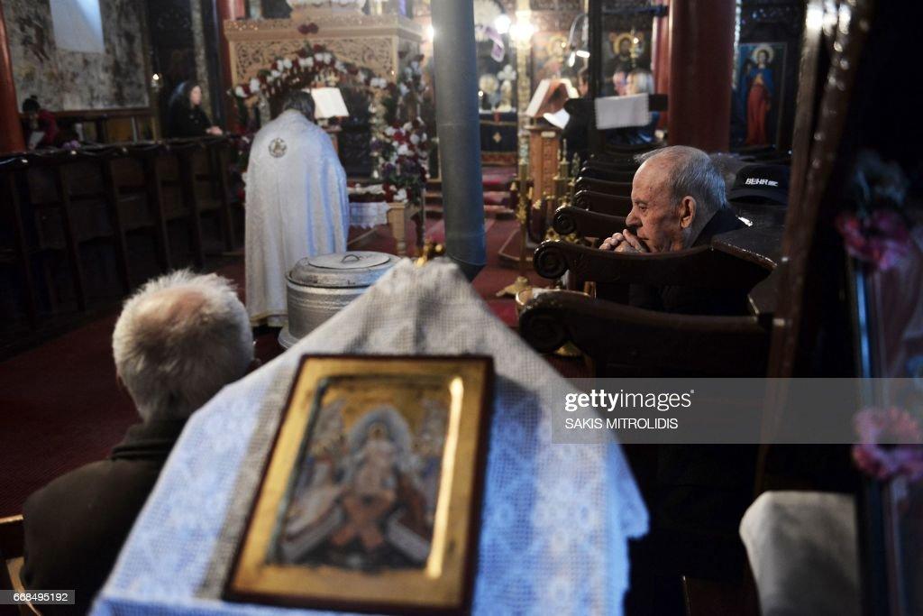 Greek Orthodox pilgrims attend a church service following