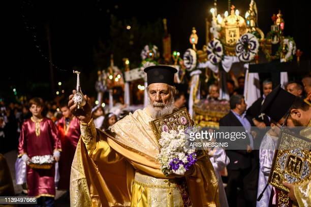 A Greek Orthodox priest blesses the crowd during Good Friday's 'Apokathelosis' the Descent of Christ's dead body from the Cross which forms a key...