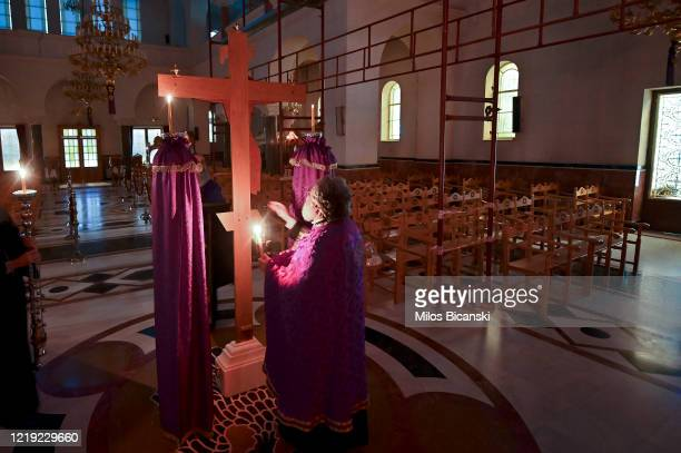 Greek Orthodox priest Father Nikolaos performs mass in empty church transmitted live on the web on April 16 2020 in Athens Greece As part of its...