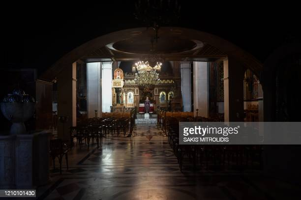 A Greek Orthodox priest stands in an empty church due to the spread of the novel cornoavirus during a religious ceremony marking the Apokathelosis...