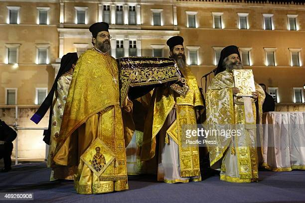 Greek Orthodox priests carry the Epitaphios on stage outside the Greek parliament Thousands of people lined the street for this year's Good Friday's...