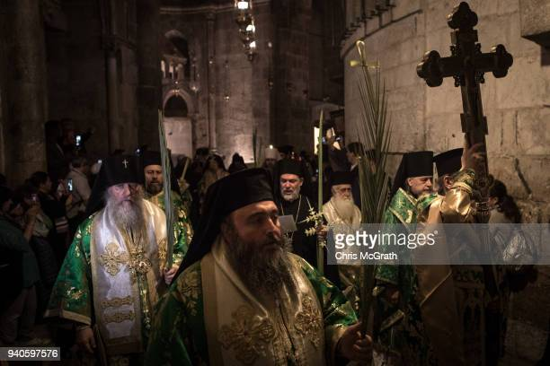 Greek Orthodox priests lead a procession through the Church of the Holy Sepulchre in the Old City on April 1 2018 in Jerusalem Israel Thousands of...