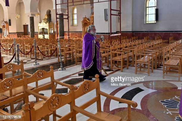 Greek Orthodox priests perform mass transmitted live on the web on April 16 2020 in Athens Greece As part of its COVID19 quarantine measures the...
