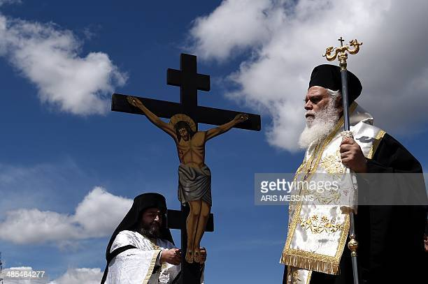 Greek Orthodox priests stand around of an image of Jesus crucified during the ceremony marking the Apokathelosis the removal of Christ's dead body...