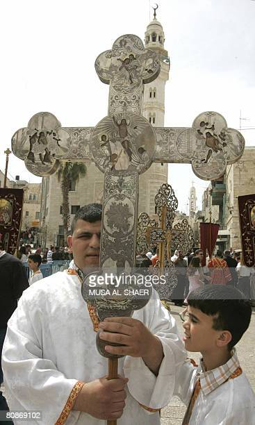 Greek Orthodox worshippers celebrate the arrival of the 'Holy Fire' in the Church of the Nativity in the West Bank city of Bethlehem on April 26 2008...