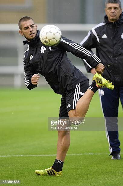 Greek Panathinaikos' football team striker Croatian Mladen Petric controls the ball during a training session on July 29 in Liege a day ahead of...