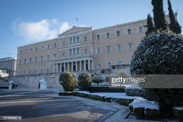 Greek Parliament seen on a snowing day. Several schools, roads and train stations has been closed because of the strong snowfall in Athens.