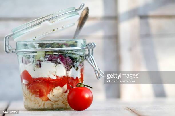 greek pasta and vegetables salad in a jar