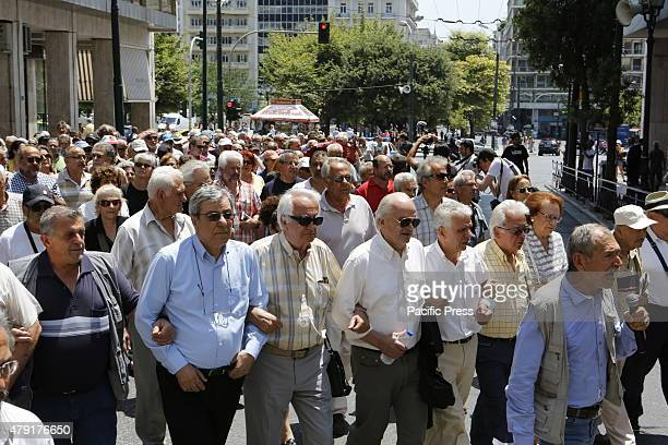 Greek pensioners have formed a human chain during the march from the finance ministry to the Greek Central Bank Greek Pensioners marched from the...