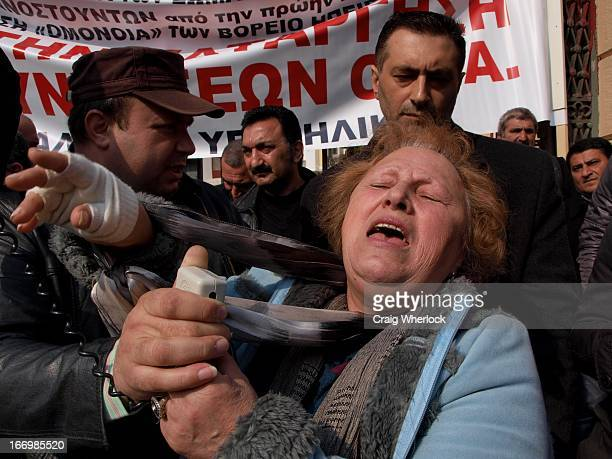 Greek pensioners in despair gather outside government building to protest further cuts in pensions and benefits. Thessaloniki, Greece.