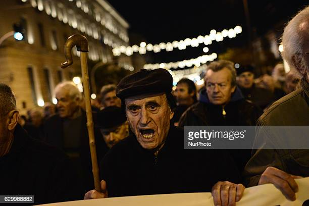 Greek pensioners take part in an antiausterity demonstration in central Athens to protest years of austerity cuts to their pensions on November 15...