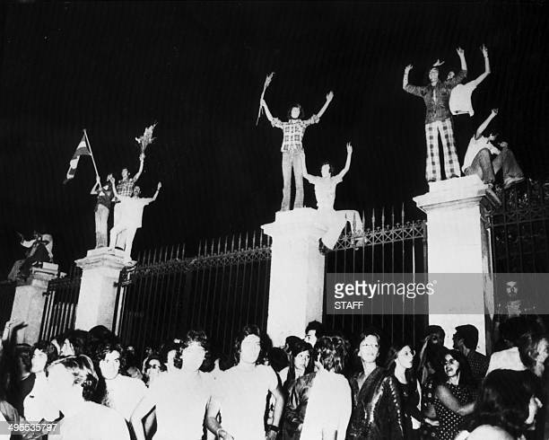 """Greek people celebrate after the fall of the dictatorship and the announcement of a new government, on July 24, 1974 in Athens. """"The regime of the..."""