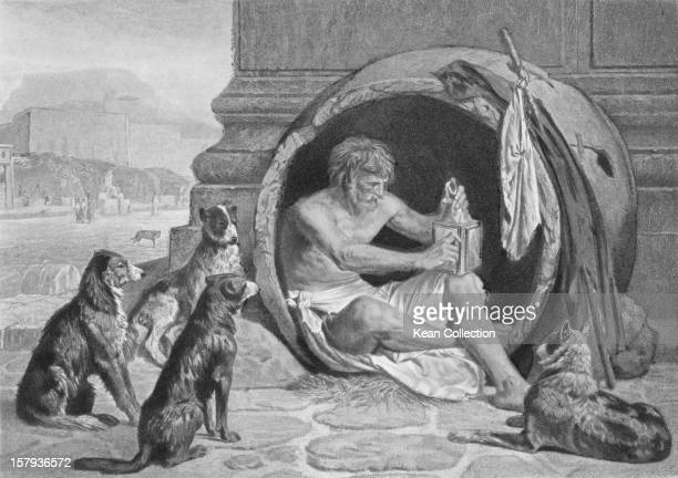 Greek philosopher Diogenes of Sinope also known as Diogenes the Cynic circa 350 BC He is depicted living on the streets in a large jar and surrounded...